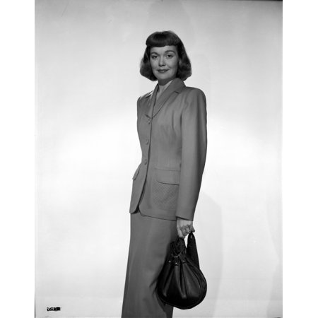 Jane Wyman Posed in Grey Linen Long Sleeve Tweed Suit Dress and Long Skirt with Right Hand Holding a Black Velvet Handbag Photo Print