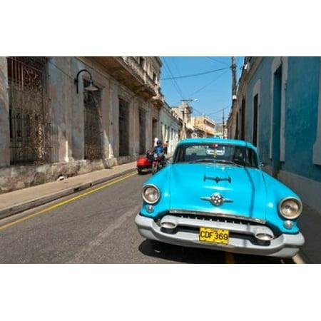 Cuba Camaquey Oldsmobile car and buildings Canvas Art - Bill Bachmann DanitaDelimont (36 x 24)