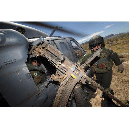 Soldiers prepare to reload a 50 caliber machine gun on an HH-60 Pave Hawk Poster Print by Stocktrek - Padme Gun