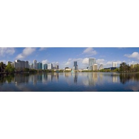 Reflection of buildings in a lake Lake Eola Orlando Orange County Florida USA 2010 Canvas Art - Panoramic Images (18 x