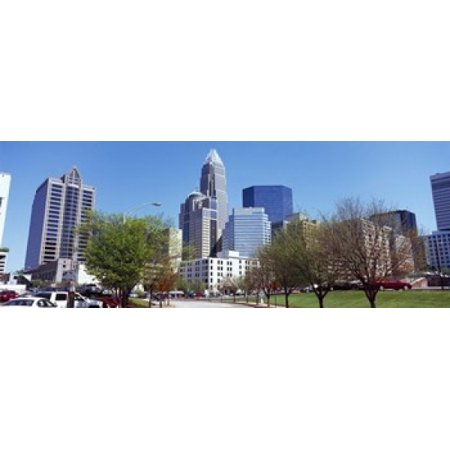 Skyscrapers in a city Charlotte Mecklenburg County North Carolina USA 2011 Canvas Art - Panoramic Images (15 x 6)