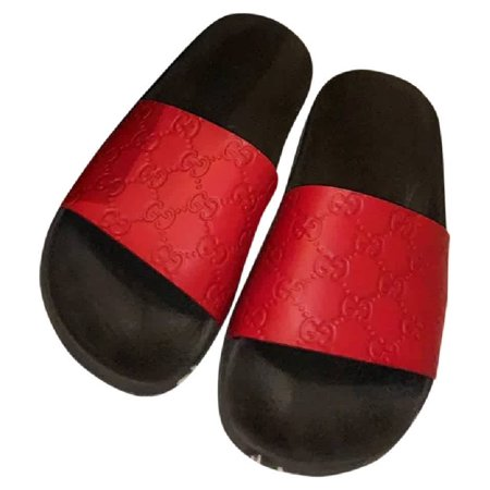 Gucci Ladies Gucci Signature Slide Sandals Gucci Ladies Sandals. SKU: 454330 CWC00 6433. Color: Red. Gucci Ladies Gucci Signature Slide Sandal. Features an embossed pattern with Gucci logo and a molded rubber foot bed. Material: 100% Rubber. Made in Italy.