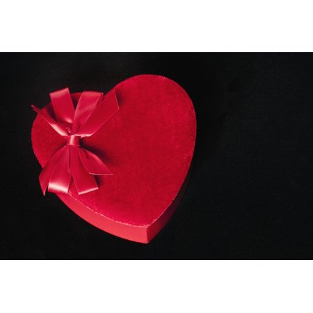 Valentines heart-shaped candy box against black background Stretched Canvas - Bill Brennan  Design Pics (19 x 12)