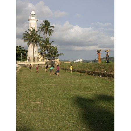 Boys playing cricket Galle Lighthouse and rampart around Galle Fort Galle  Southern Province Sri Lanka Poster Print