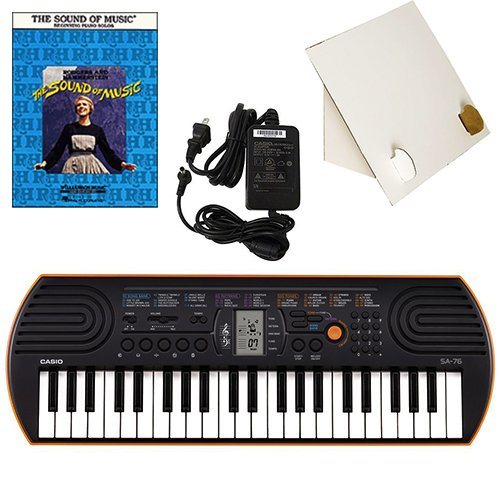 Casio SA-76 44 Key Mini Keyboard Deluxe Bundle Includes Bonus Casio AC Adapter, Desktop Music Stand & The Sound of Music Beginning Piano Solo Songbook