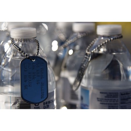 LAMINATED POSTER Dog tags hang from water bottles at the finish line of the Run for the Fallen Half-Marathon/5K, Nov. Poster Print 24 x 36 - To And From Tags For Halloween