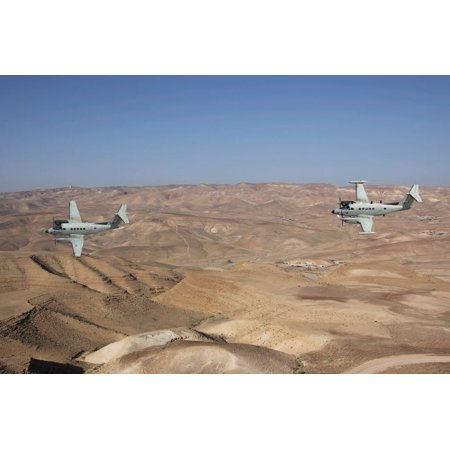 A pair of Israeli Air Force B-200 Tzofit in flight over Israel Poster Print by Ofer ZidonStocktrek Images