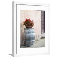 Europe, Italy, Tuscany. Flower Pot on Old Wine Barrel at Winery Framed Print Wall Art By Julie Eggers
