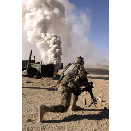 November 7 2006 - A US Army Soldier reacts to a controlled explosion during training at the National Training Center on Fort Irwin California Poster