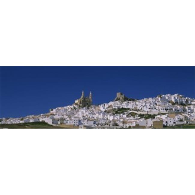 Panoramic Images PPI51605L Low angle view of a town  Olvera  One of the White Villages of Andalucia  Cadiz Province  Spain Poster Print by Panoramic Images - 36 x 12