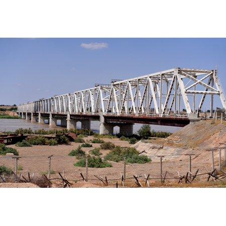 LAMINATED POSTER The Friendship Bridge runs across the Amu Darya River between Uzbekistan and Afghanistan. The frie Poster Print 24 x 36 ()