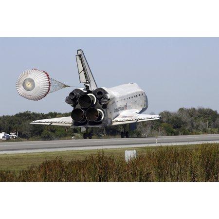 Space shuttle Atlantis unfurls its drag chute upon landing at Kennedy Space Center Florida Poster Print