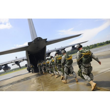 Us Army Air Force - August 3 2009 - US Army Rangers board a US Air Force MC-130 Combat Talon II aircraft at Fort Benning Georgia before a Ranger Rendezvous 2009 mass tactical jump Poster Print