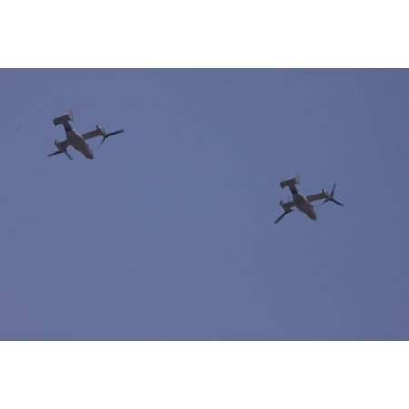 LAMINATED POSTER Two MV-22B Ospreys fly over Wing One Royal Thai Air Force Base, Nakhon Ratchasima, Kingdom of Thaila Poster Print 24 x 36
