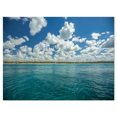 White Fluffy Clouds Over Sea - image 2 de 3