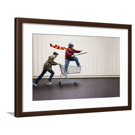 Two People Dressed up as Super Heroes or Characters Horsing around in a Shopping Cart with Goggles Framed Print Wall Art By Annette Shaff - Best Film Characters To Dress Up As