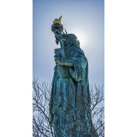 Sun shining behind Statue of Liberty torch Liberty Island New York City New York United States of America PosterPrint (Statue Of Liberty Torch)