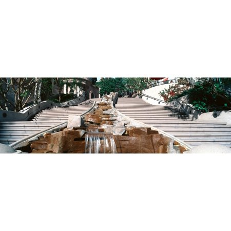 Panoramic view of stairs and waterfall in downtown Los Angeles California lead into a shopping area Poster