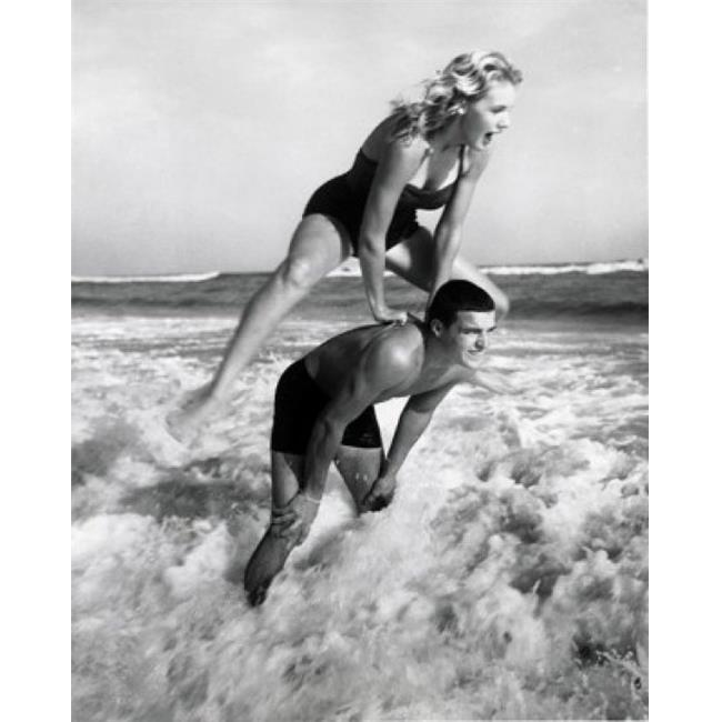 Posterazzi SAL2558787 Young Couple Playing Leapfrog in Surf Poster Print - 18 x 24 in. - image 1 de 1