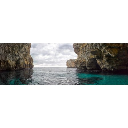 Rock formations in Mediterranean sea Blue Grotto Malta Poster Print