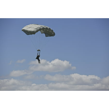 LAMINATED POSTER A U.S. Army Green Beret conducts a High Altitude, Low Opening Airborne Jump over Iron Mike Drop Zone Poster Print 24 x 36 (Airborne Beret)