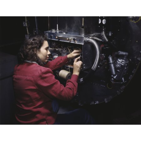 Woman assembling switch boxes on the firewalls of a B-25 bomber 1942 Poster Print by Stocktrek