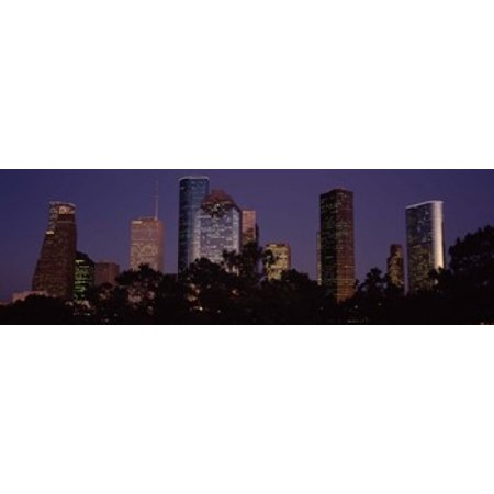 Buildings in a city lit up at dusk Houston Harris county Texas USA Poster