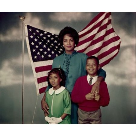Portrait of a mid adult woman standing with her daughter and son in front of an American flag Canvas Art -  (18 x