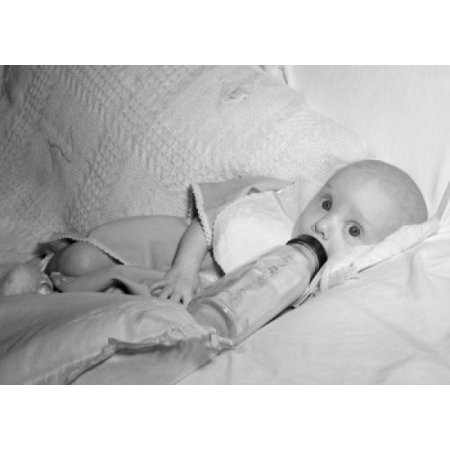 Baby With Baby Bottle On Sofa Poster Print