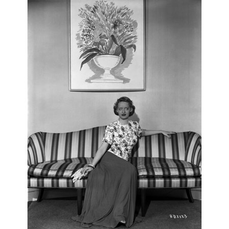 (Bette Davis Seated on a Striped Couch in High Neck Short Sleeve Floral Dress and Silk Skirt Photo Print)