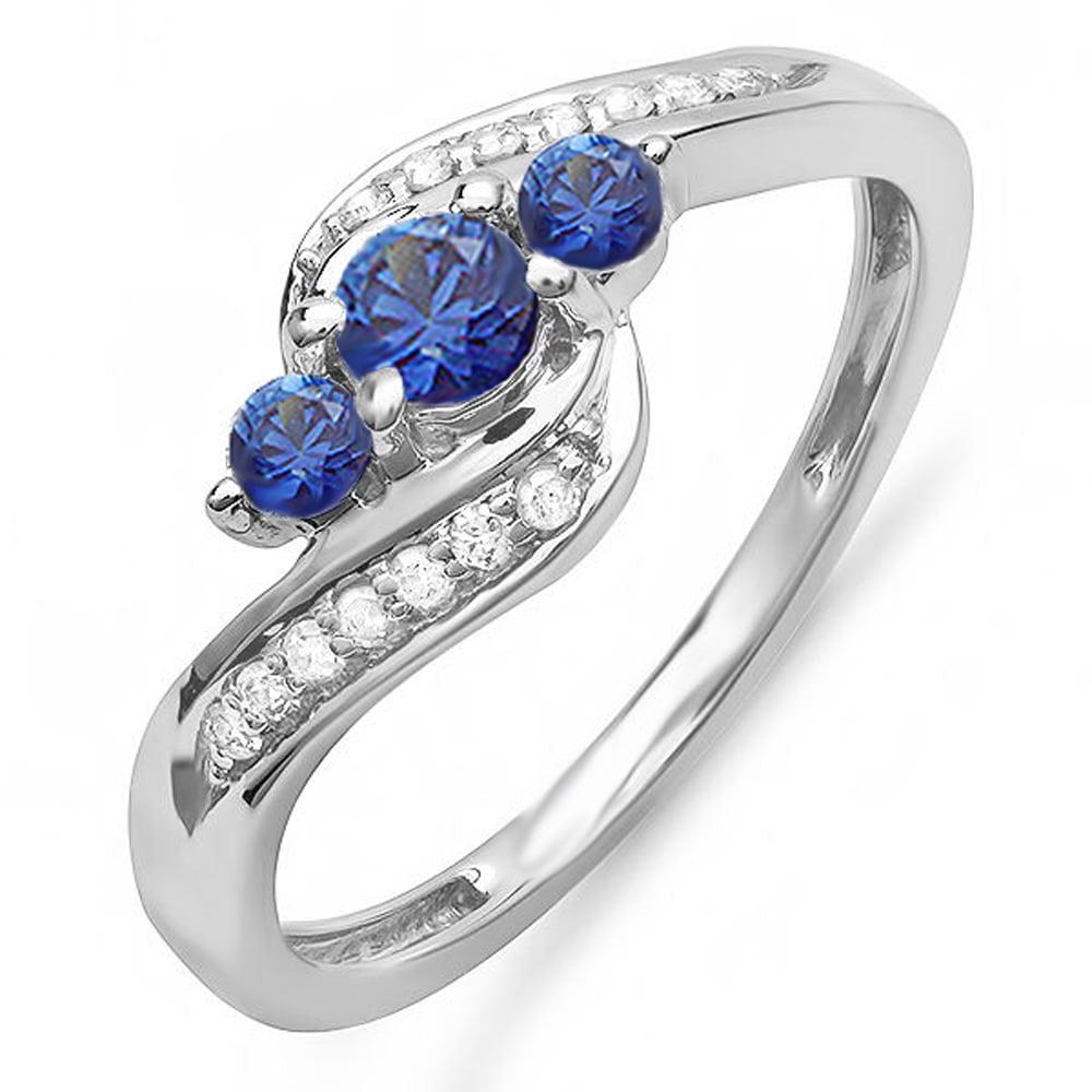 14K White Gold Round Blue Sapphire And White Diamond Ladies Swirl Engagement 3 Stone Bridal Ring by DazzlingRock