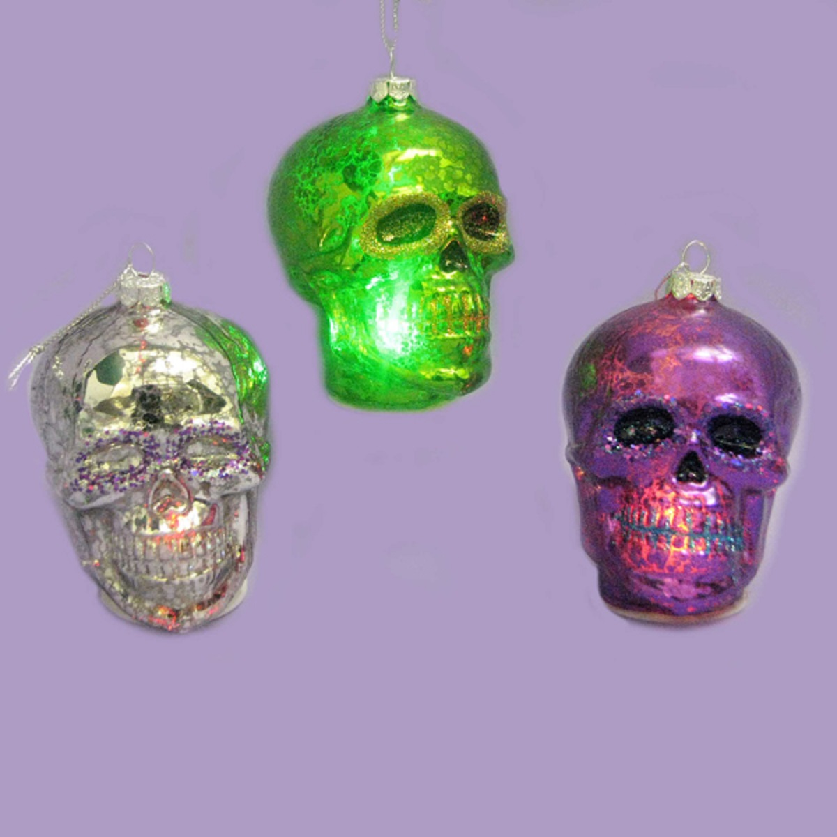 Pack of 6 Green, Purple and Silver Glass LED Light-up Skull Halloween Ornaments 3.25""