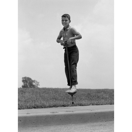 1960s Boy Jumping On Pogo Stick Rolled Canvas Art - Vintage Images - 1960s Boys