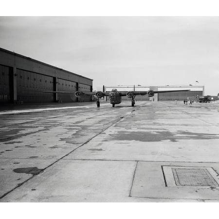 A B-24E Liberator bomber taxiing down a runway circa 19421943 Poster Print by Stocktrek (Liberator Usaaf Bomber)