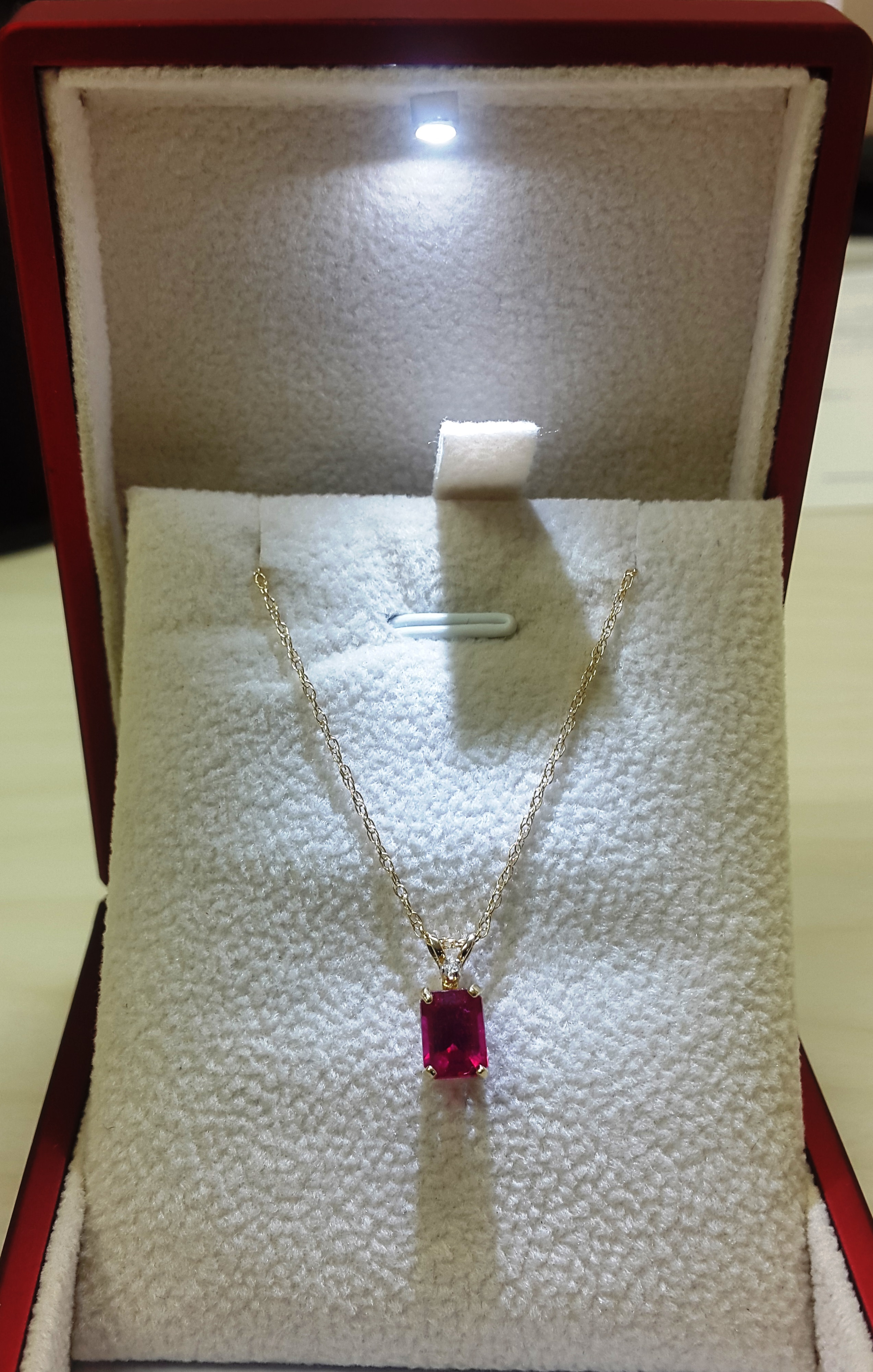Classic 1 Carat Emerald Shaped Natural Ruby with 0.01 Ctw Solitaire Diamond Necklace In 14K Yellow Gold by Diamond Princess