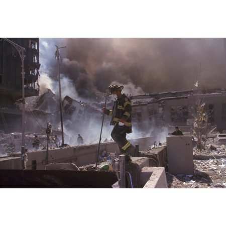 Fire Fighters Amid Smoking Rubble Following September 11Th Terrorist Attack On World Trade Center At Left Is Still Standing Wtc 6 At Right Is The Destroyed North Pedestrian Bridge Over West Side