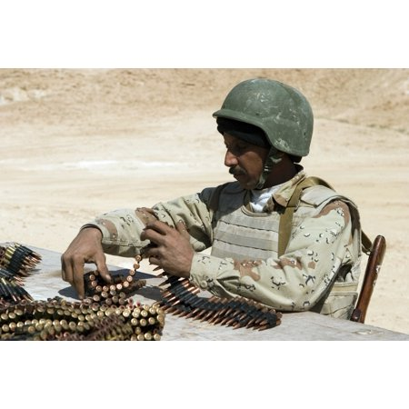 An Iraqi army soldier prepares belts of ammunition for his PKM 762-mm machine gun Canvas Art - Stocktrek Images (34 x 23)