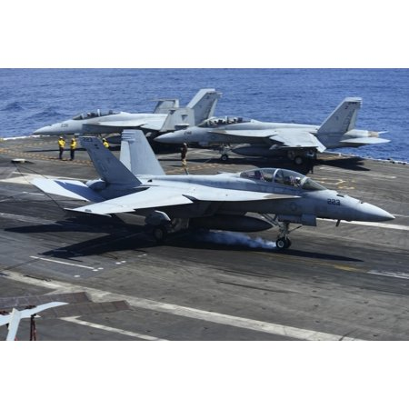 Atlantic Ocean April 17 2013   An Fa 18C Hornet From The Romans Of Strike Fighter Squadron 106 Lands On The Flight Deck Of The Aircraft Carrier Uss George Hw Bush Poster Print