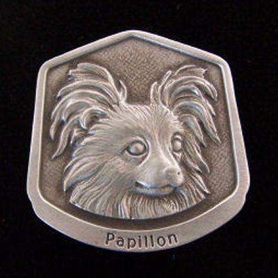 Papillon Fine Pewter Dog Breed Ornament The sculpted image of your pet is surrounded with a wreath of holly and ivy. You will treasure this ornament for years to come. hey are made of Fine Pewter and come in a Christmas gift box for storing. Lindsay Claire is a Canadian manufacturer of Fine Pewter Gifts and Collectibles.  Each pewter item is cast in our shop from fine pewter and meticulously hand polished to a satin finish.Ornament is approximately 3  and has a satin cord attached for hanging.