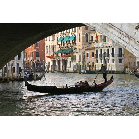 Tourist in a Gondola as They Pass under the Rialto Bridge, Venice, Italy Print Wall Art By David