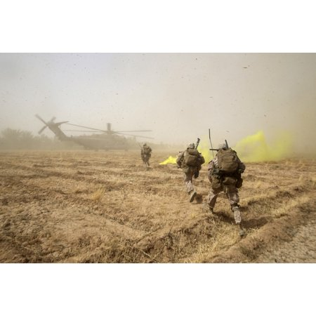 July 4 2014   Us Marines Sprint Across A Field To Load Onto A Ch 53E Super Stallion Helicopter During A Mission In Helmand Province Afghanistan Poster Print