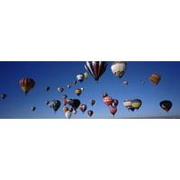Hot air balloons floating in sky Albuquerque International Balloon Fiesta Albuquerque Bernalillo County New Mexico USA Canvas Art - Panoramic Images (36 x 12)