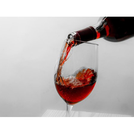 USA, Washington State, Seattle. Red wine pours into a glass. Print Wall Art By Richard Duval