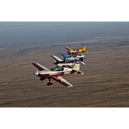 Extra 300 aerobatic aircraft fly in formation during APS training in Mesa Arizona Poster (16 Extra Length Aircraft)