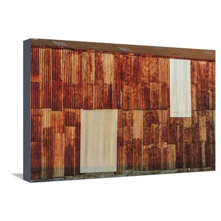 Close-up of rusted corrugated metal panels. Stretched Canvas Print Wall Art By Stuart Westmorland