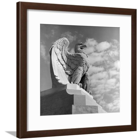 1960s Eagle Statue Against Sky Clouds Wings Spread Feathers Talons Curled over Edge of Base Framed Print Wall Art