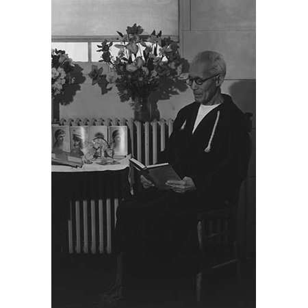 Harry Sumida full-length portrait seated facing left reading a book next to a small table Oldest Neisi in Center  Ansel Easton Adams was an American photographer best known for his black-and-white pho