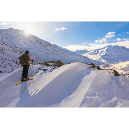 A Backcountry Skier Looks Over The Black Rapids Glacier Valley From A High Point On The Terminal Moraine In Winter Alaska United States Of America Poster Print By Steven Miley  Design Pics