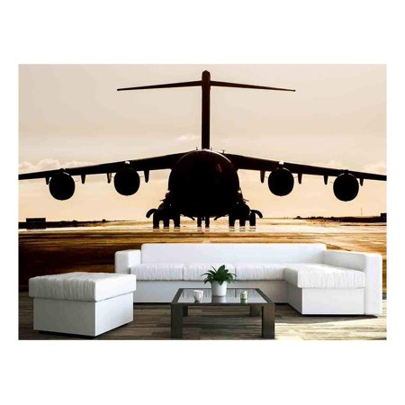 wall26 - Large military cargo plane silhouette on an empty airstrip - Removable Wall Mural | Self-adhesive Large Wallpaper - 100x144