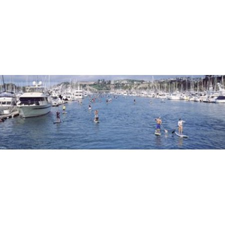 Paddleboarders in the Pacific Ocean Dana Point Orange County California USA Canvas Art - Panoramic Images (18 x